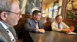 Joe DeVizia of county Human Services and Frank Castano of Children and Youth Services listen to Dave Tevet, owner of Ollie's restaurant, discuss a food program he has devised for needy children. Pete g. wilcox/the times leader